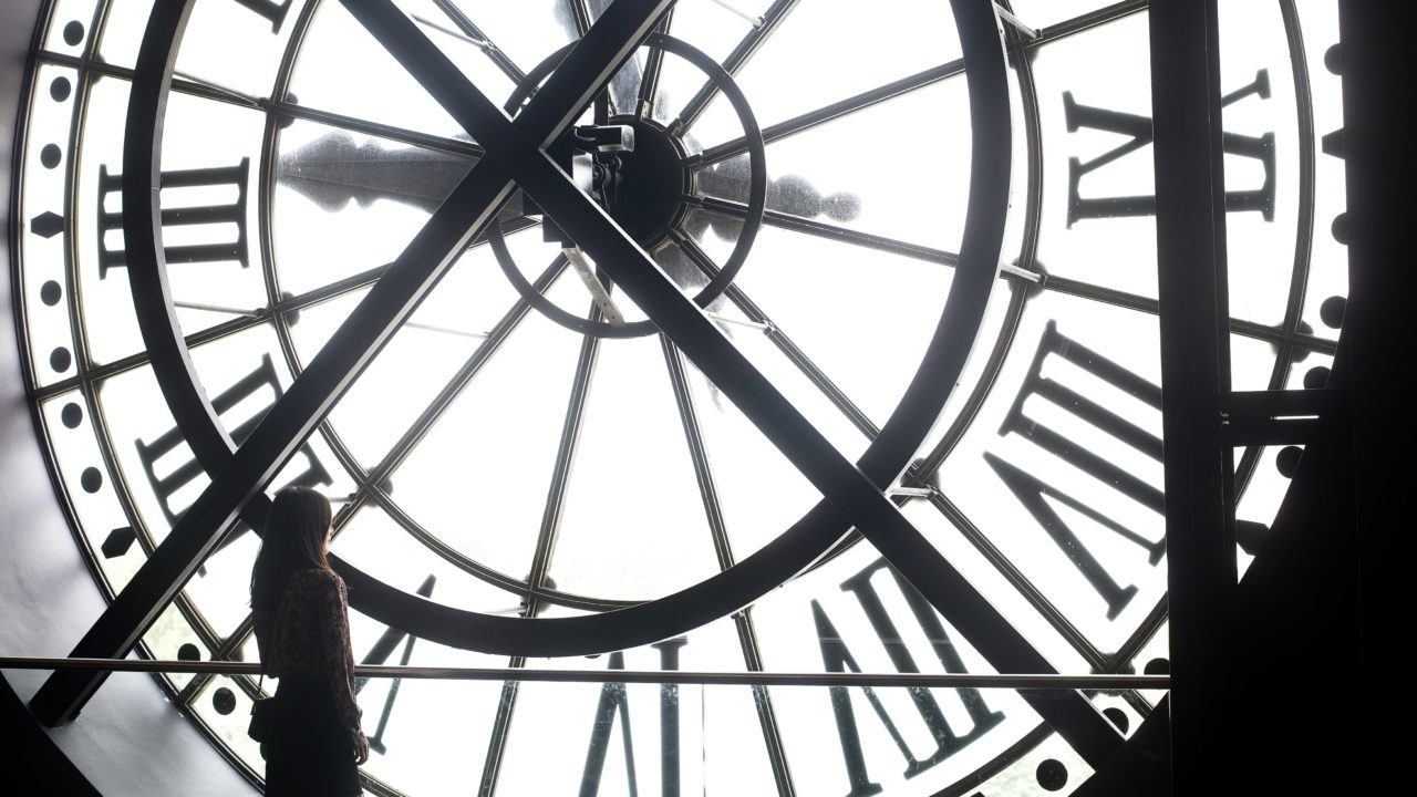 https://educfrance.org/wp-content/uploads/2020/05/a-woman-stands-at-the-back-of-a-massive-white-clock-face-1280x720.jpg