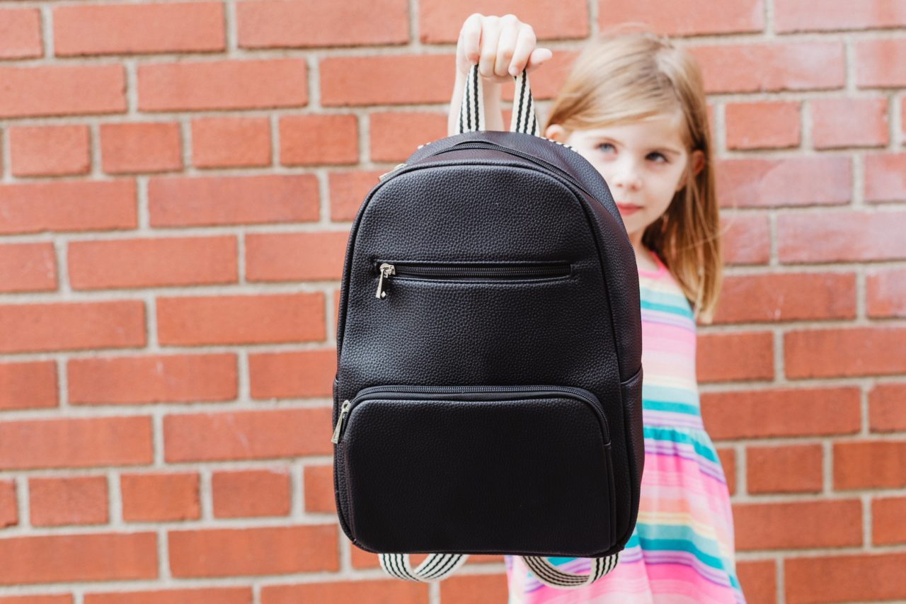 https://educfrance.org/wp-content/uploads/2020/05/back-to-school-holding-out-backpack-1280x853.jpg