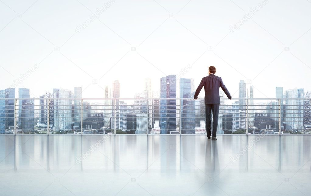 https://educfrance.org/wp-content/uploads/2020/05/depositphotos_40549817-stock-photo-businessman-standing-on-a-roof.jpg